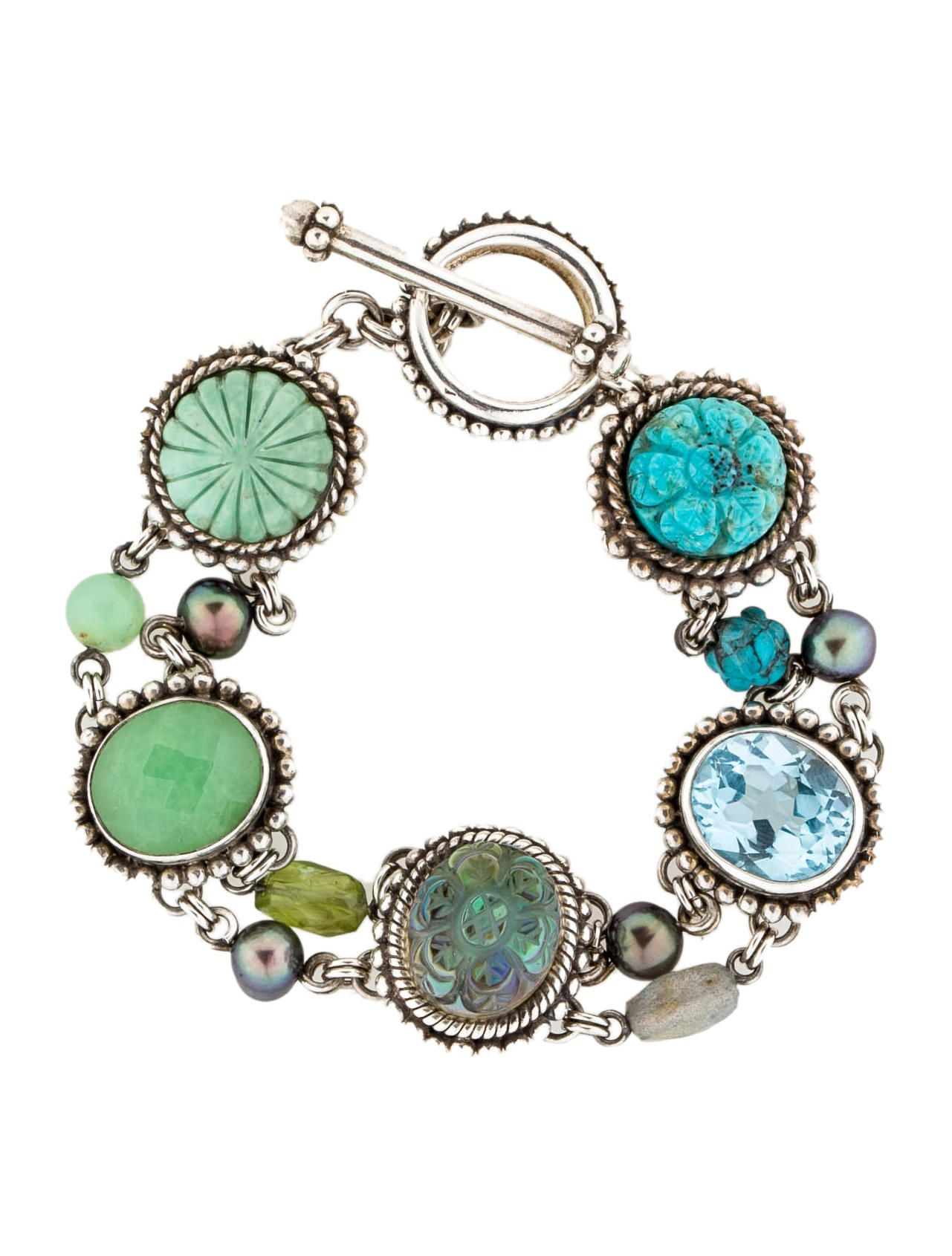 Sterling Silver Stephen Dweck carved stone bracelet with blue topaz, turquoise green chrysoprase and black mother of pearl doublet accents and textured toggle closure. $275.00