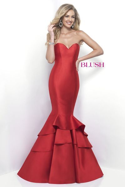 Mermaid silhouette that features a strapless sweetheart neckline and a fitted bodice that flares at the knee into a tiered trumpet skirt. Back zipper closure.