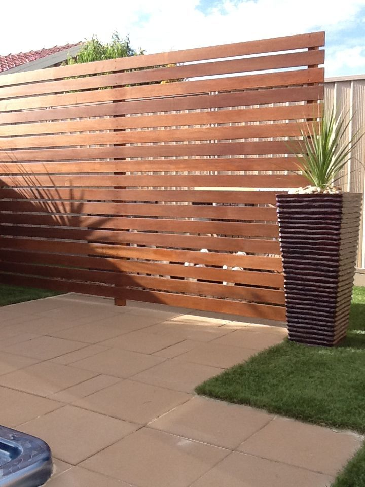 merbau screen used to hide spa pool pumb and filter paving and artificial turf done by exseed landscaping in deer park