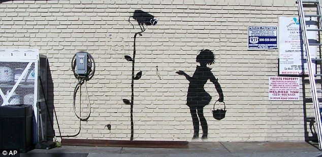 Hollywood Gas Station Owner Sells Banksy Mural For 209 000 Banksy Mural Banksy Art Street Art