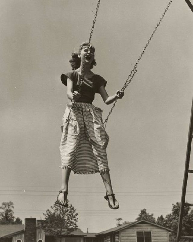 Picture of woman swinging vintage