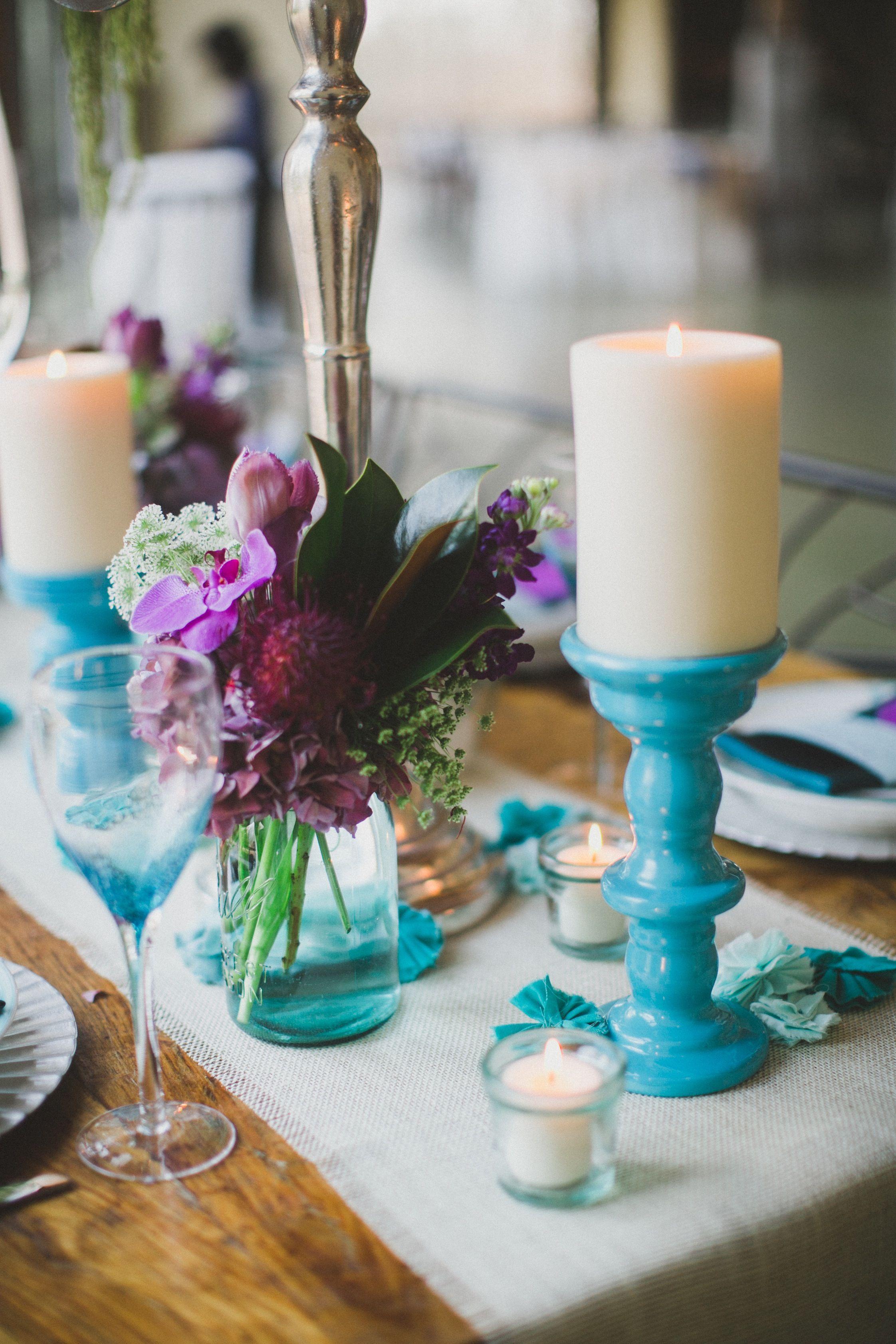 Blue mason jars with blue purple green hydrangeas and greenery will