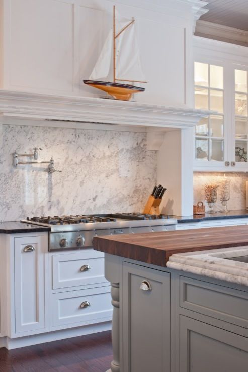 Two Tone Black Countertops With White Cab And White Marble With