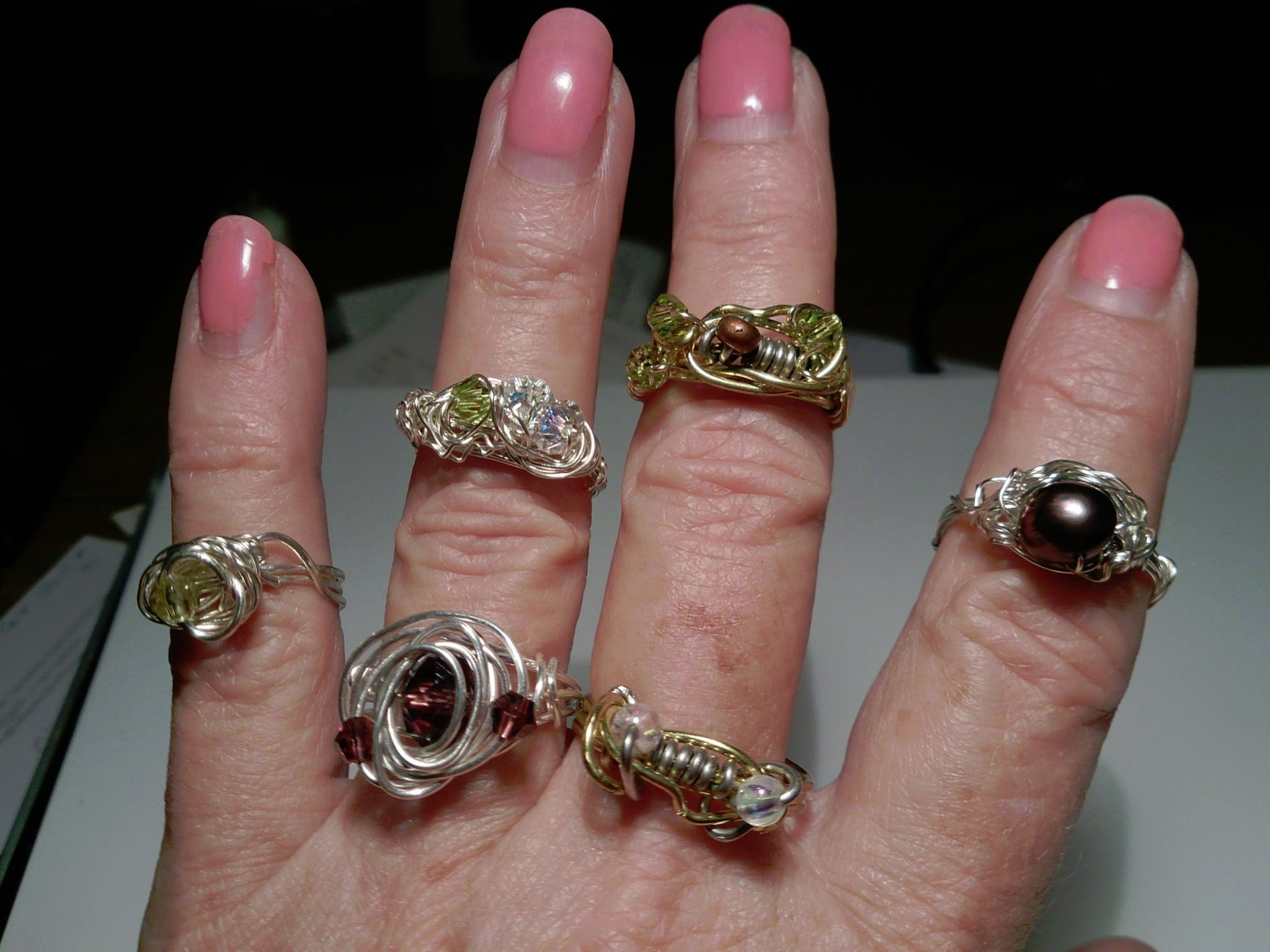 Rings: brass or silver craft wire, bicones and beads, freshwater pearl, AB beads.