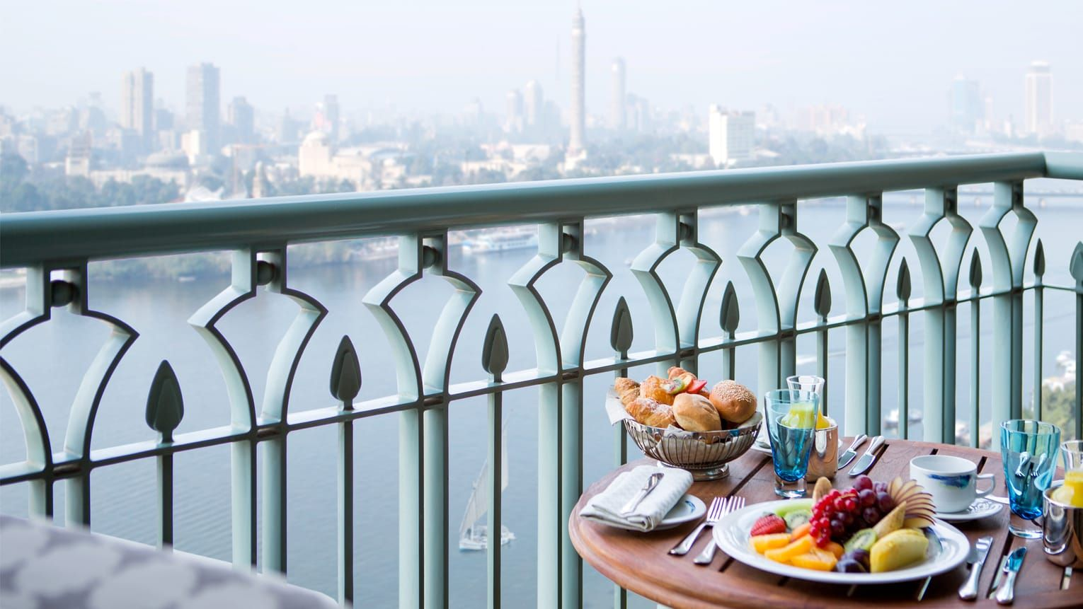 Home interior fruit plates closeup of balcony table with plate of fresh fruit bread and