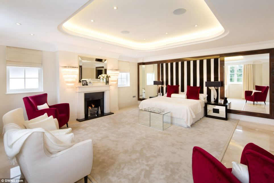 Spacious: The Houseu0027s Master Bedroom Has Been Decorated In Stylish Cream  With Red Velvet A