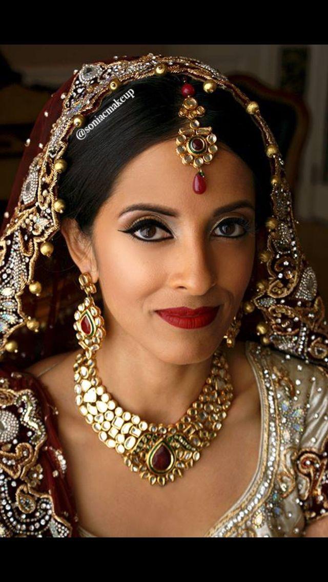 Indian bride, ceremony makeup, red lips, dulhan, kundan jewelry, tikka, uncut diamonds, Sonia c bride, bridal makeup