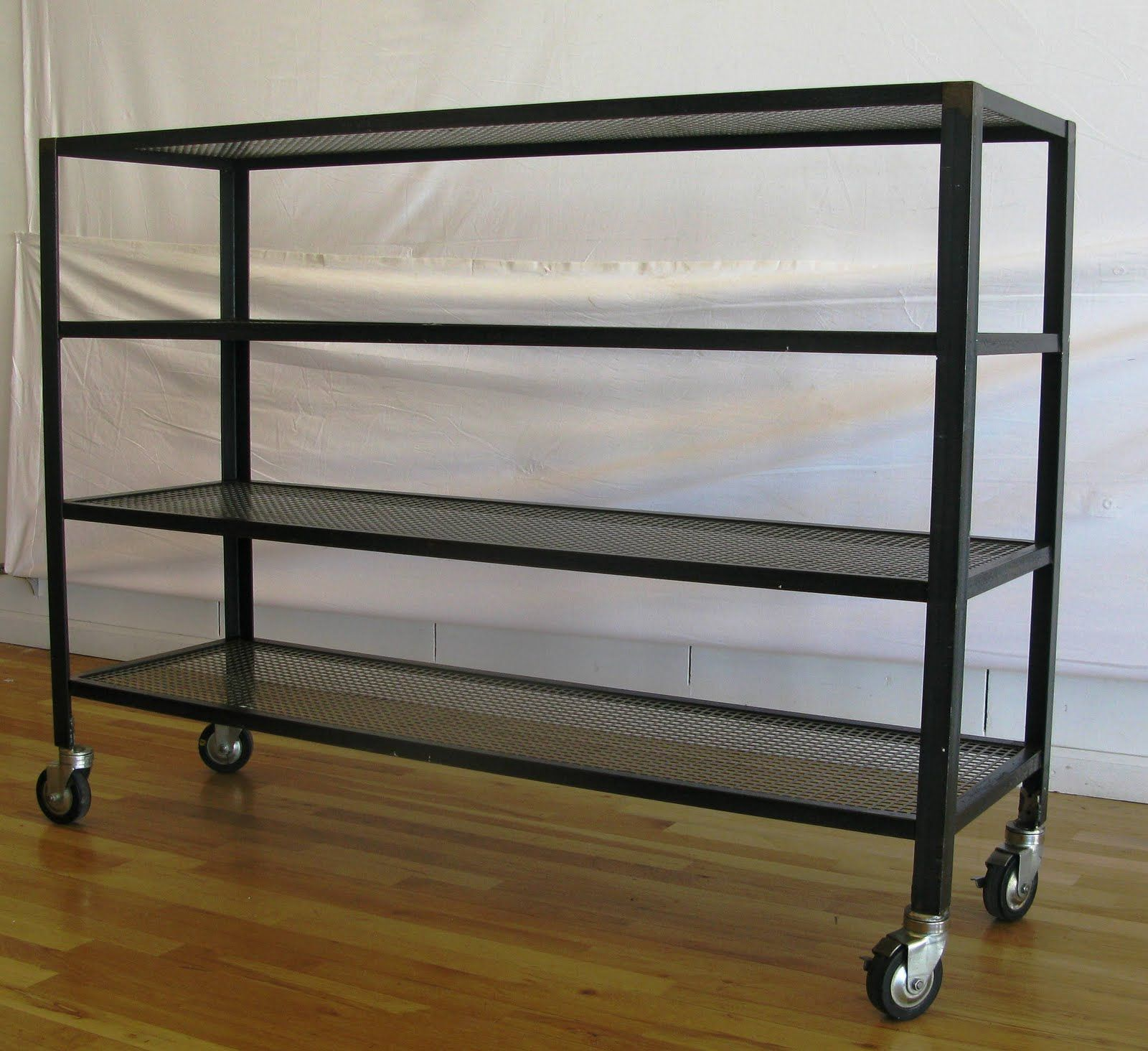 Industrial metal shelves on casters for basement breezeway and garage
