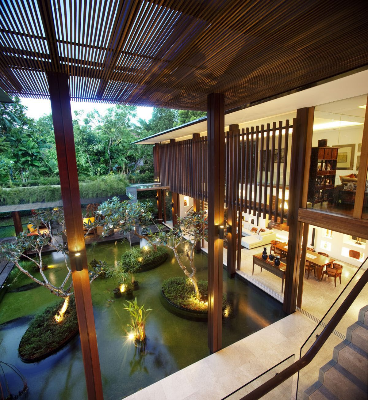 the sun house in singapore. l shaped with an open courtyard and