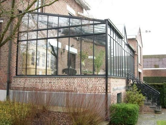 Wintertuin mooie combinatie van steen en glas stijl for Meubilair plaza huizen