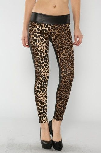 LEOPARD PLEATHER LEGGINGS...LEOPARD PRINT LEGGINGS WITH PLEATHER DETAIL ON BACK WITH FOLDER ELASTIC BANDED ON WAISTLINE. 97% POLYESTER, 3% SPANDEX...MADE IN THE USA.