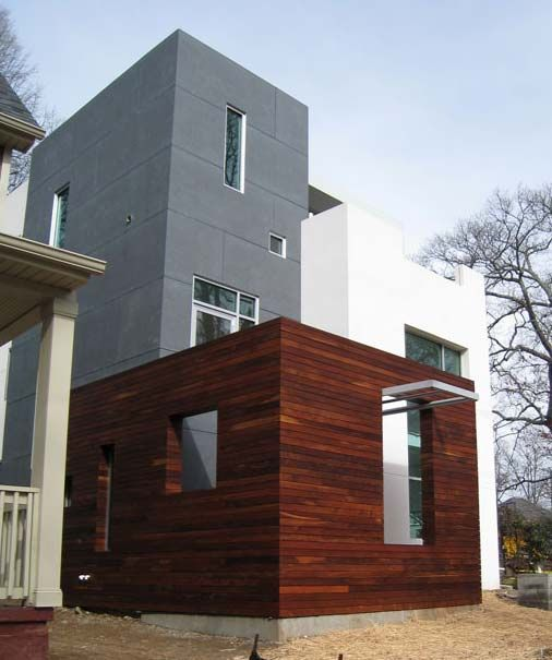 Rethinking natural wood siding a house by the park for Stucco substitute