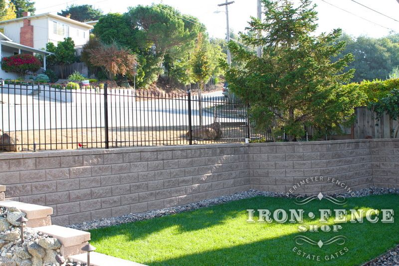 4ft Wrought Iron Fence Acting As A Safety Barrier On Top Of A Wall