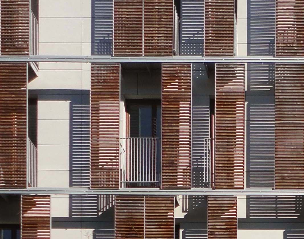 Wood slide shutters places to visit pinterest facades architecture and modern architecture for Exterior louvered window shutters