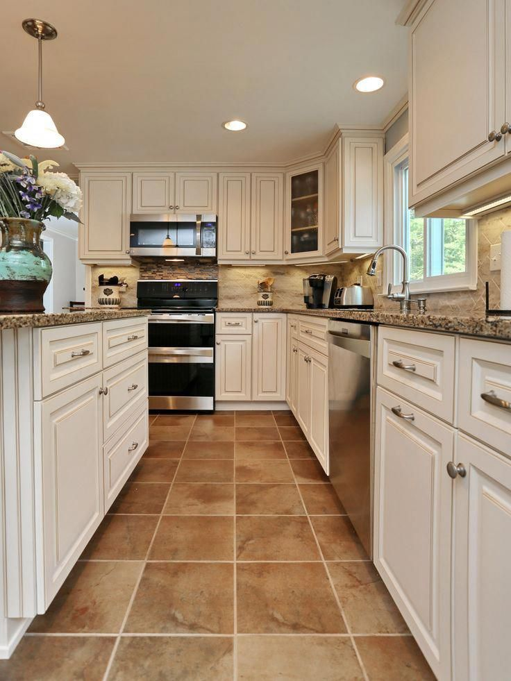 Have You Ever Seen a Canterbury Kitchen  - Tuscan kitchen, Kitchen floor tile, Kitchen renovation, Kitchen design, Kitchen flooring, Kitchen remodel - Check out the beautiful before and after pictures from this dramatic kitchen makeover featuring Cambria in Canterbury and Antique White cabinets