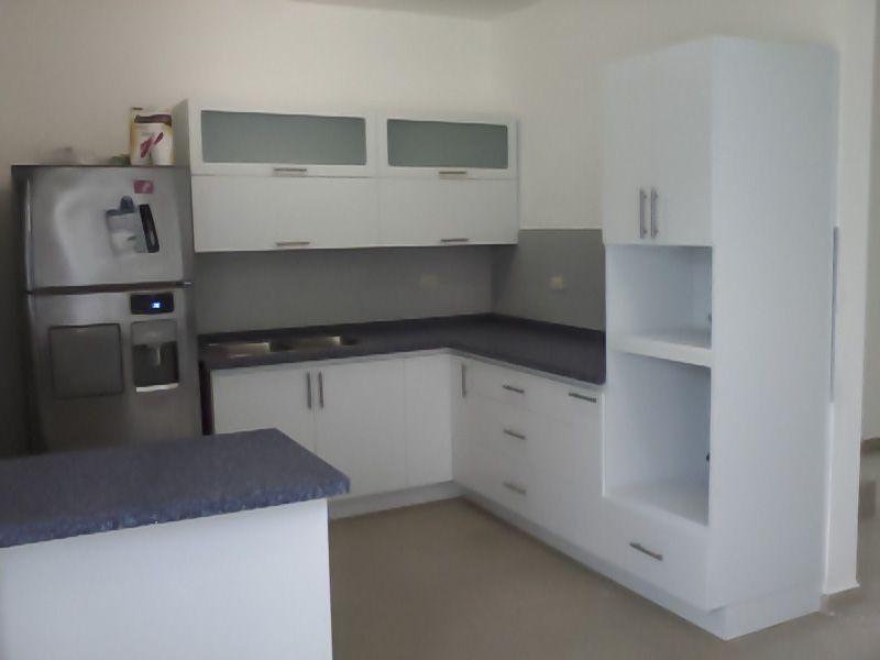 Minimalist kitchen blue corian countertop cocina - Cocinas minimalistas ...