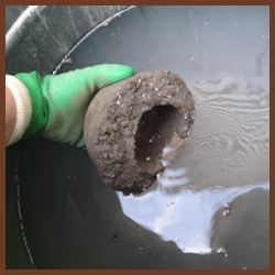 Curing your Hypertufa - Lower your container very gently into water bath.