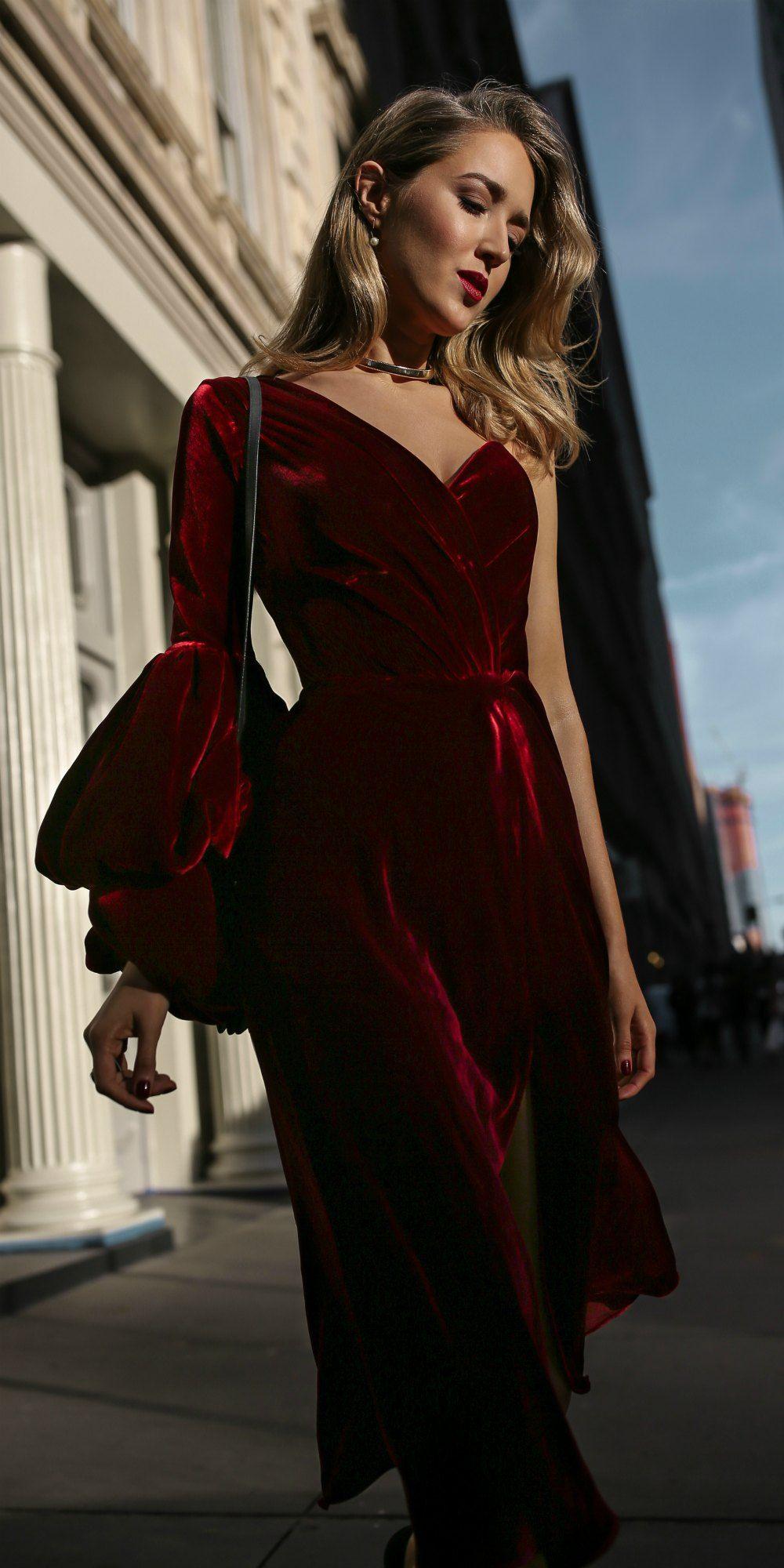 Red velvet asymmetrical dress gold choker red lips black bow