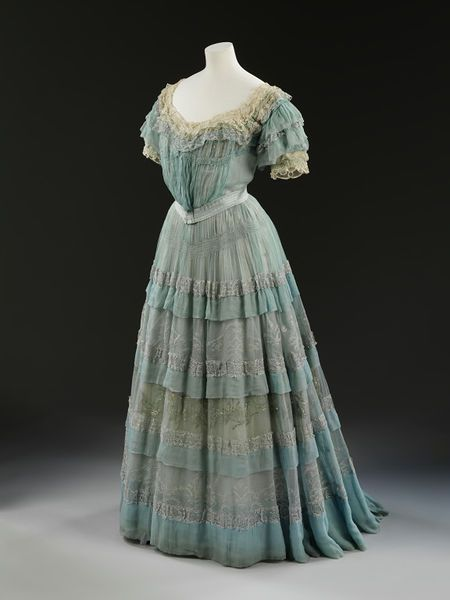 1905, England - Evening dress 'Carresaute' by Lucile - Silk chiffon over silk linings, boning, metallic embroidery, lace, ribbon flowers, self fabric ruffles and frills
