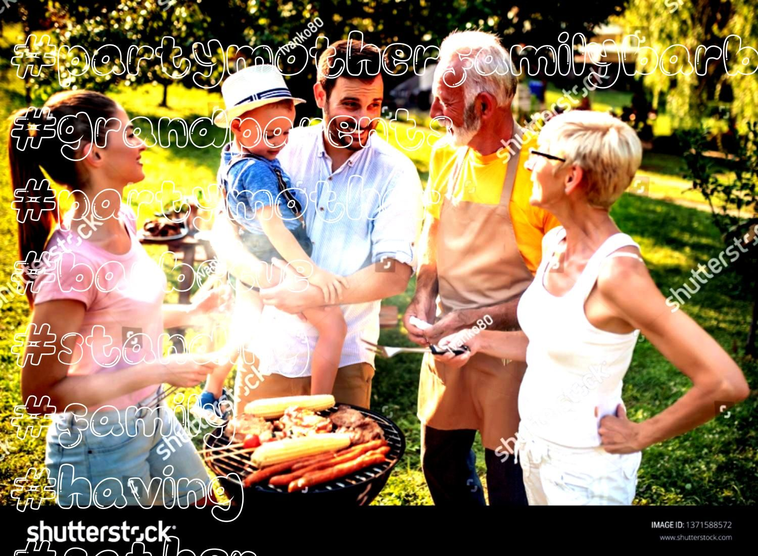having a barbecue partymother father son and grandparents standing around the grill Family having a barbecue partymother father son and grandparents standing around the g...