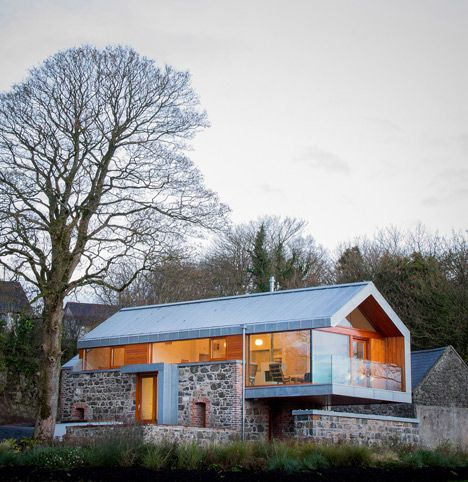 Traditional stone barn updated with a steel-framed living space ...