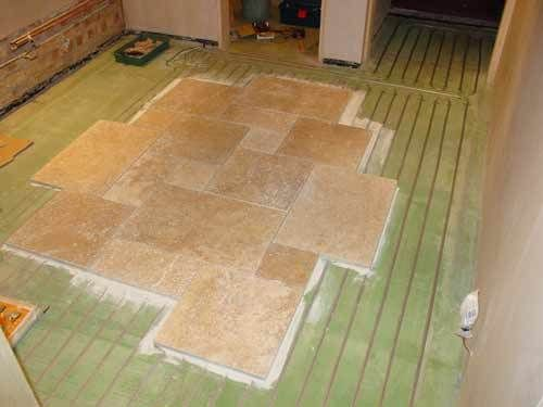 Under floor heating is often installed beneath tiled floors as they ...