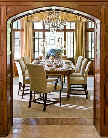 """""""The dining room curtains are fringed and formal,"""" says Barber, """"so I chose these simple DessinFournir chairs and covered them in Rose Tarlow's Arabesque in Bark on Green Tea. They're also incredibly comfortable, which was important — the owners entertain a lot."""" Louis XVI walnut dining table; 19th-century Italian chandelier; antique Oushak rug.   - HouseBeautiful.com"""