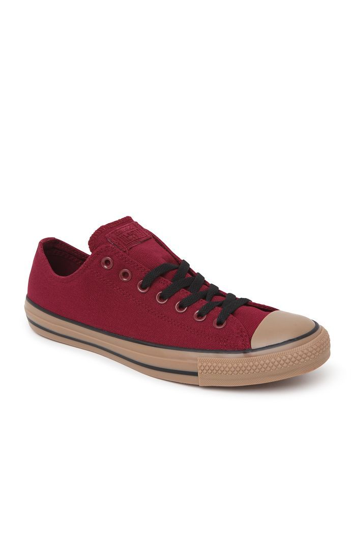 04042094ede3 Converse comes with a classic pair of men s shoes found at PacSun. The Chuck  Taylor All Star Ox Gum Shoes for men offers a burgundy canvas upper