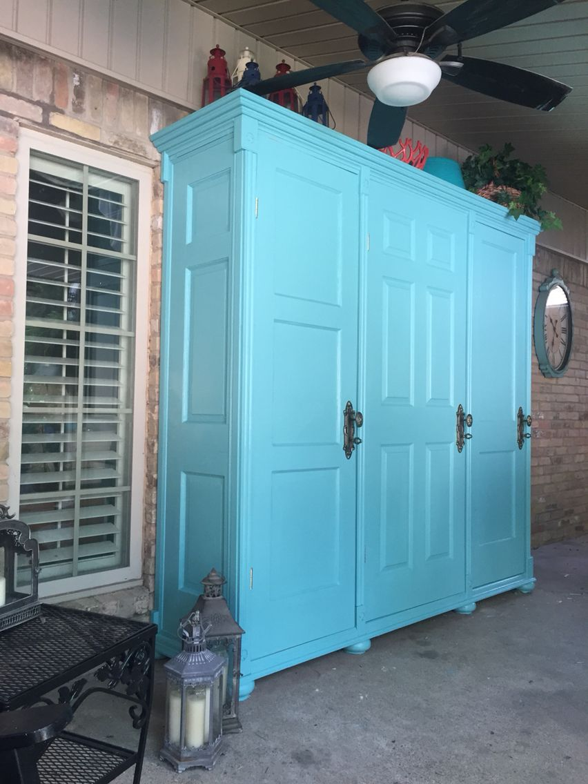 Storage for patio/porch from four vintage doors...coral color interior