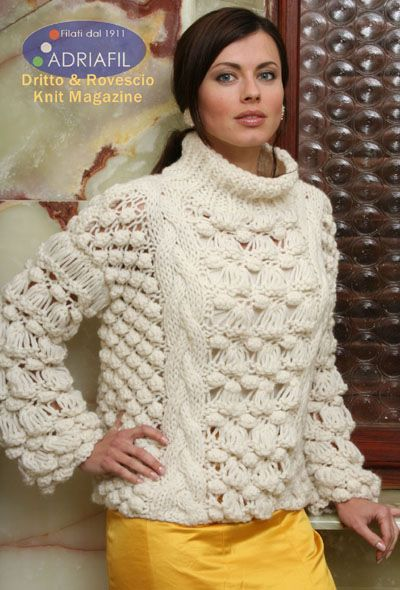 4ca716953 Free knitting pattern for a ladies sweater in chunky yarn with cable and bobble  stitch details and a turtleneck.
