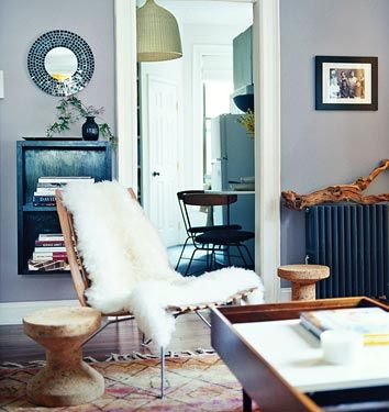I know you wouldn't be into the modern chair & light fixture but the silvery periwinkle walls, navy accents (including the radiator), worn vintage rug & rustic wood, seem sort of your style.