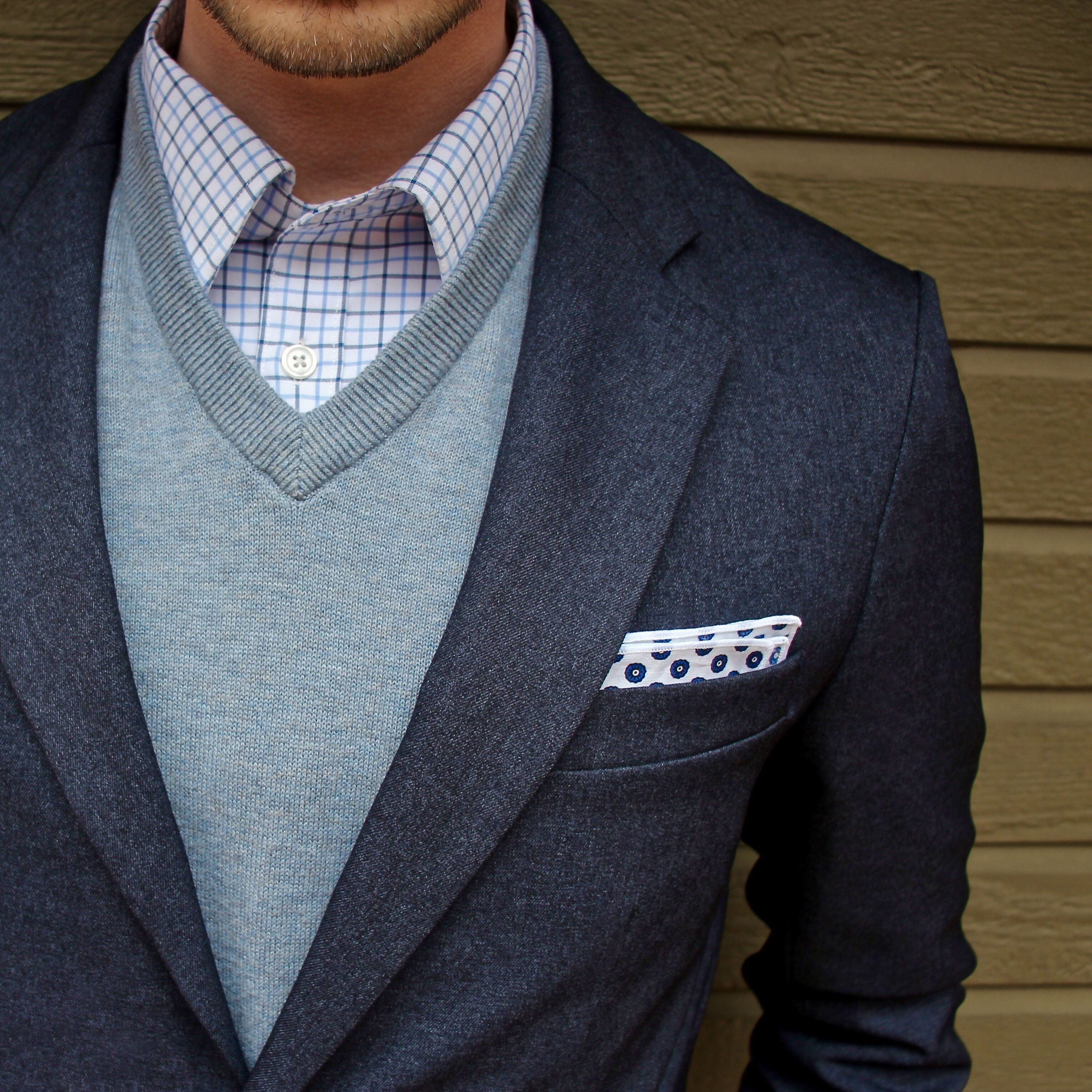5d4b6bb6f4de Business casual outfit inspiration with a navy bluffworks blazer An Ivy  pocket square light blue v-neck sweater blue plaid button up shirt. # businesscasual ...