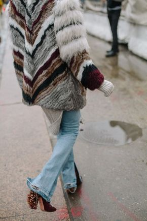 striped faux fur jacket and light jeans