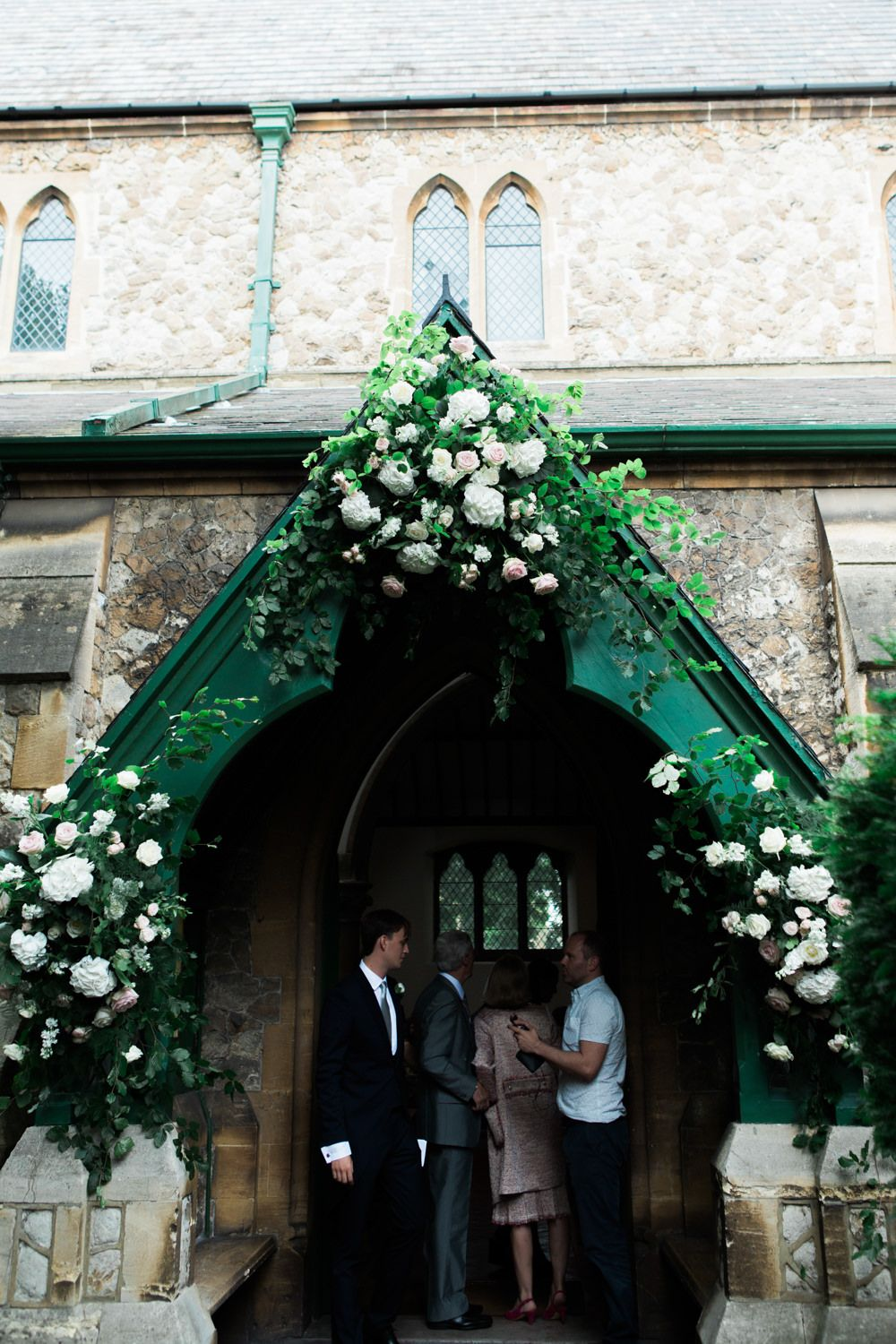 Church Entrance Flowers Lucy Davenport Photography English Country Garden Marquee Wedding Essense Dress Pink Multiway Bridesmaid Dresses