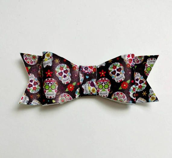 Sugar skull bow. Available on alligator clip or nylon headband.