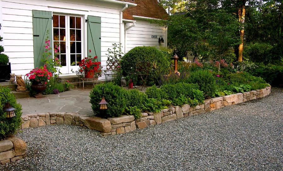 english style garden sandstone wall flagstone patio provided by macqueen design rollingbay 98061
