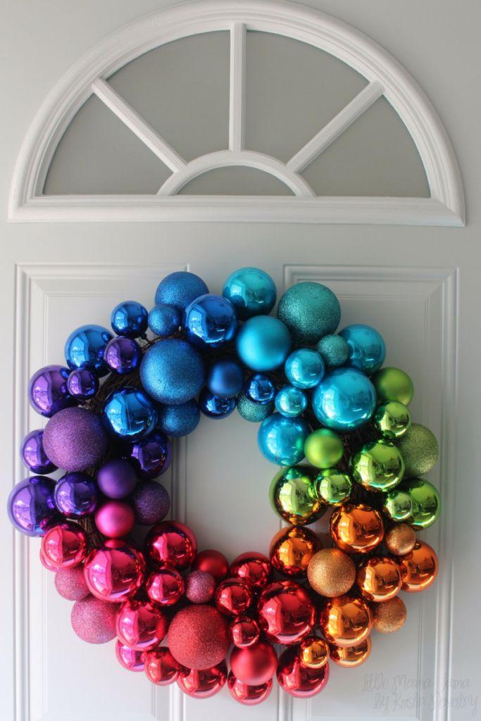 Bright holiday decor with a rainbow ornament wreath.