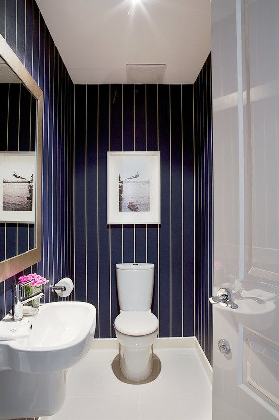 love the dark blue walls with the white tiny stripes for bathroom