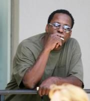 Bobby Brown smoking a cigarette (or weed)