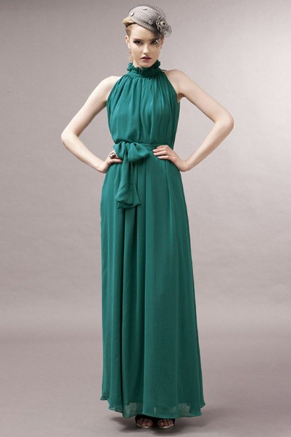 This elegant teal chiffon maxi dress featuring glamorous flounced high neck with back ties, sleeveless styling, belt is included.