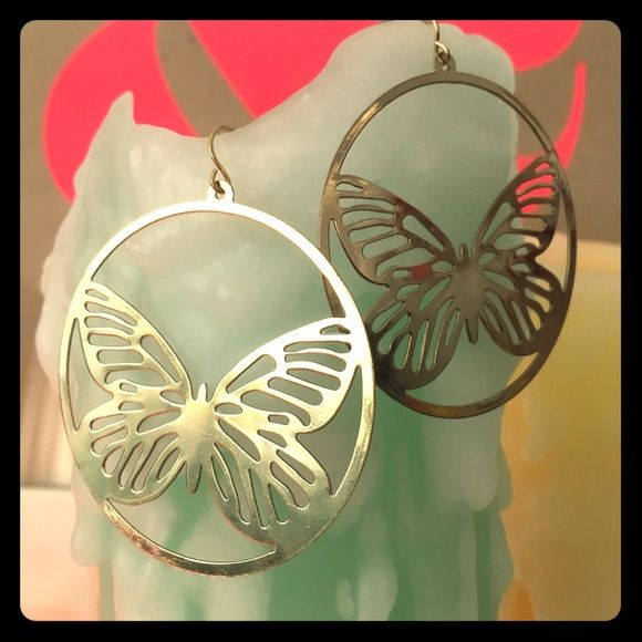 Ghetto fabulous champagne gold butterfly earrings Vintage pair of champagne gold hoop style earrings. Butterfly motif. New old stock. Never been worn. Offers welcome. No trades. Thanks for looking! Jewelry Earrings