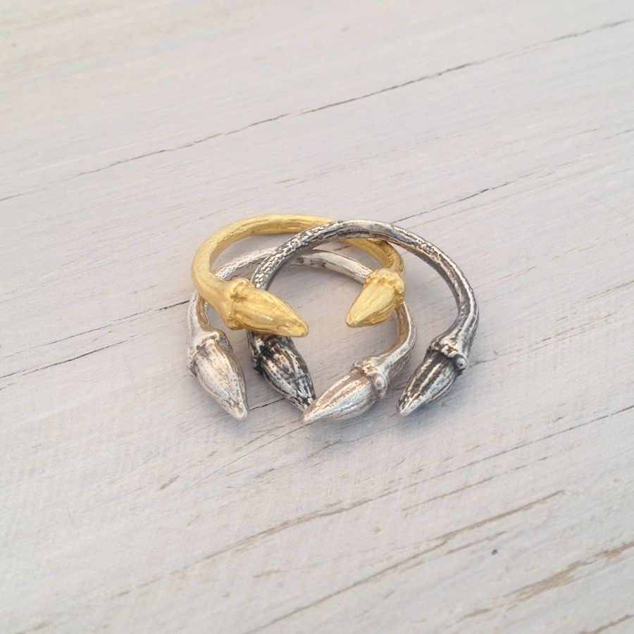 """A cool little twig ring featuring two buds meeting at the front in an open ring design. The rings look lovely and delicate on their own, or stacked, two or three together for a more obvious look. Stacking all three finishes together looks great. The ring size is K but can be adjusted to size M due to the open design.Available in three finishes: silver, oxidised silver and 18K gold vermeil.All pieces are hallmarked by Goldsmiths London.The """"Fragments of Nature"""" ..."""