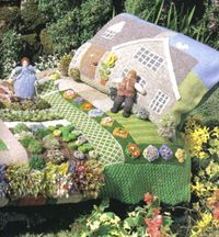 Knitted garden bedspread and pillow made by Jan Messent.