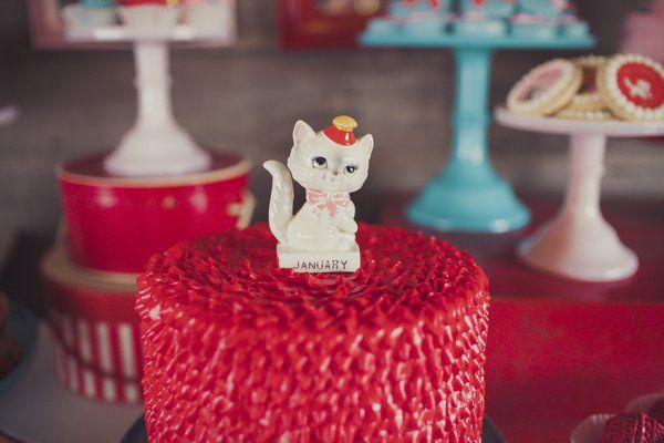 A red ruffle cake is the perfect dessert for a kitty themed birthday party Jennycookies.com