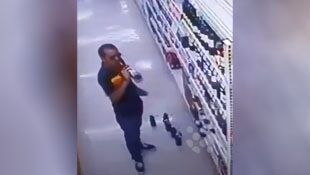 Wine thief caught sampling various bottles on grocery store security cameras #caught
