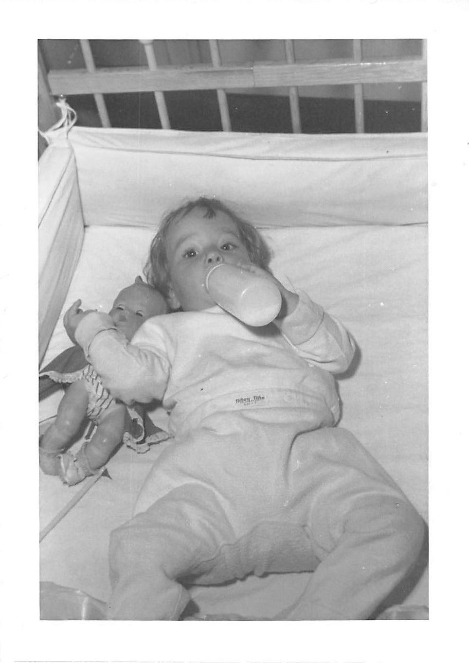 Plastic Baby Bottles And Cloth Diapers And Rubber Pants With