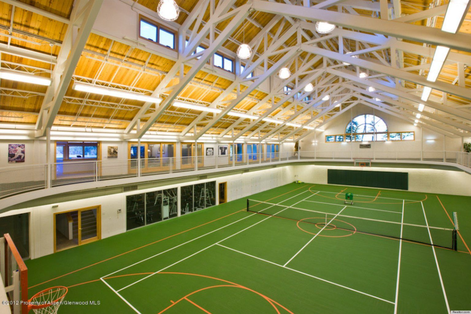 Photos 10 Homes With Tennis Courts That Have Us Ready To Pull Out Our Rackets Indoor Tennis Tennis Court Indoor Track