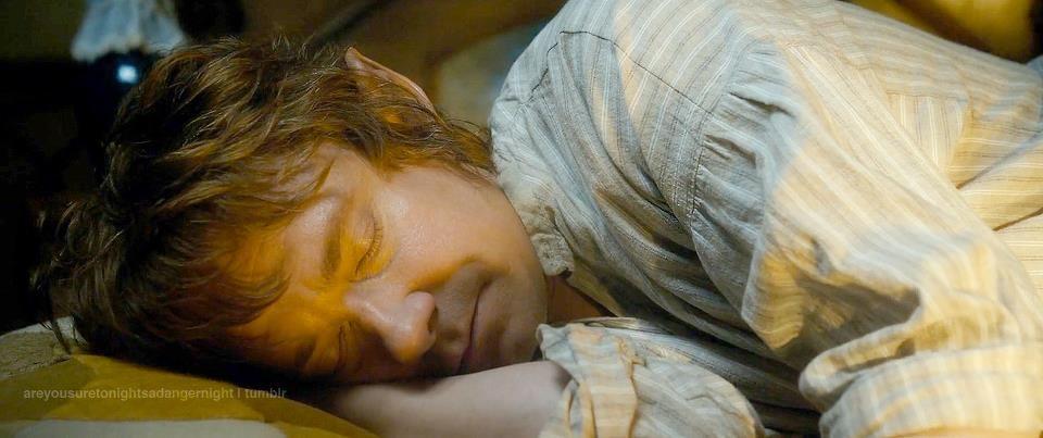 Bilbo Baggins asleep in Bag End.
