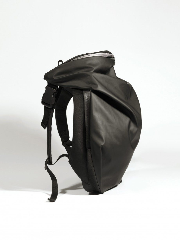 Cote&Ciel - Nile Rucksack Obsidian with hoodie on top