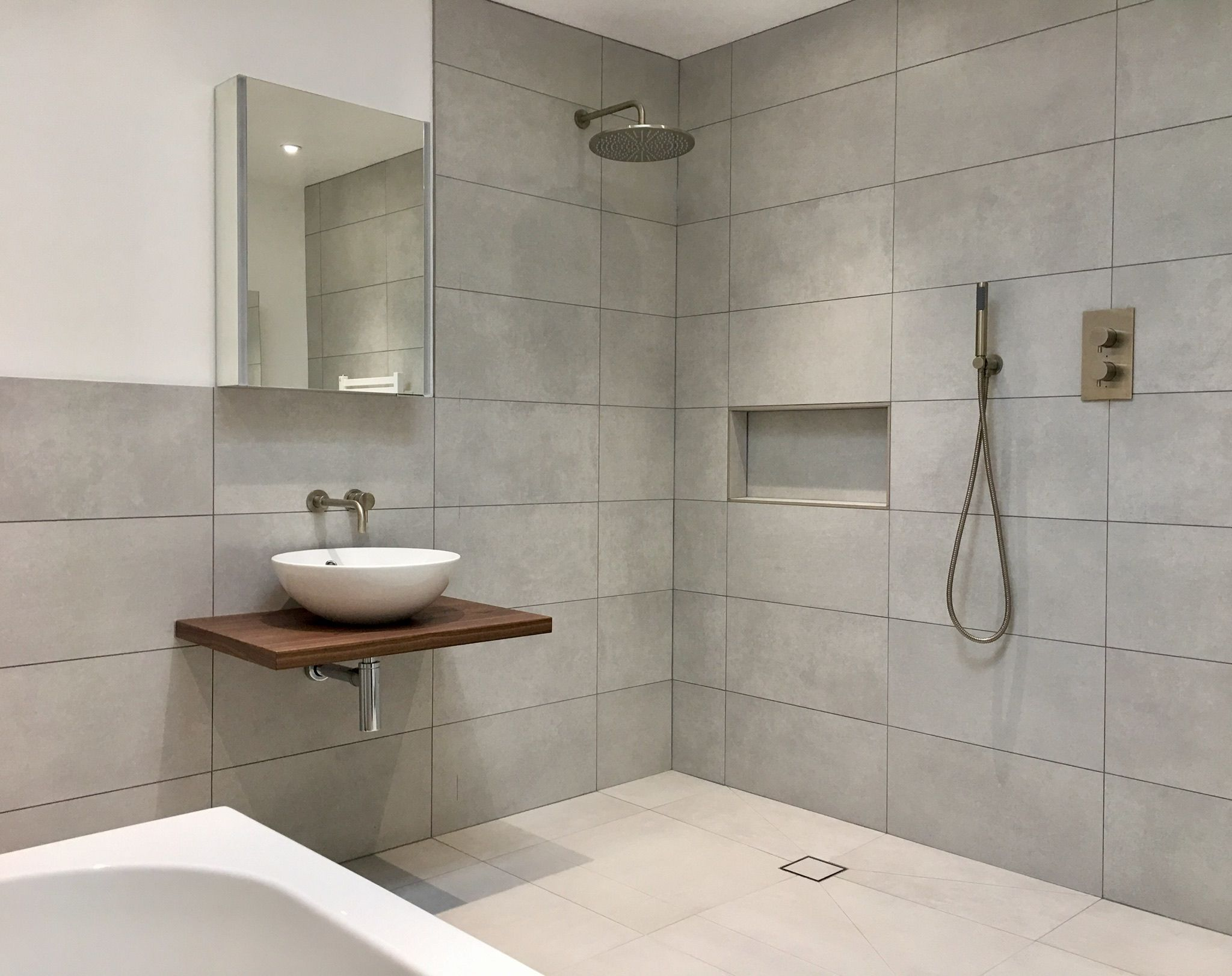 vessel sink and built in recessed shower shelf in